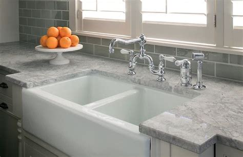 light gray quartz countertops light grey countertop with grey subway tile kitchen