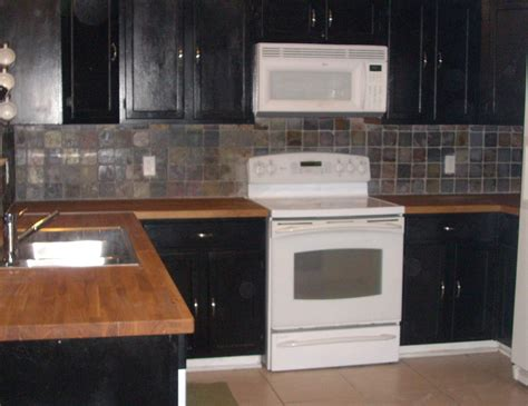 white cabinets with wood countertops white microwave above white stove for black wooden cabinet