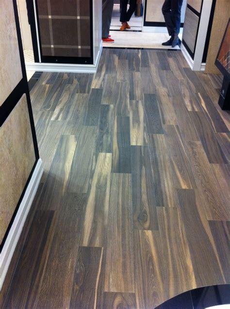 Real wood floor vs. ceramic wood look tiles?