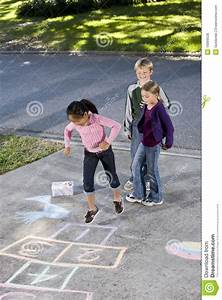 Kids playing hopscotch stock photo. Image of multi ...