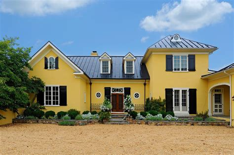 colonial front porch designs gold house exterior traditional with yellow stucco siding