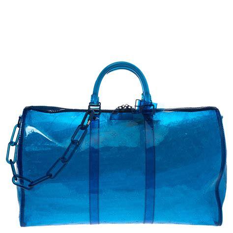 louis vuitton blue monogram prism keepall bandouliere  bag louis vuitton tlc