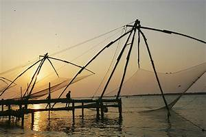 Chinese Fishing Nets Hanging In The Photograph by Axiom ...