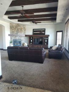 living room  dark wood beams trim  tv stand stone