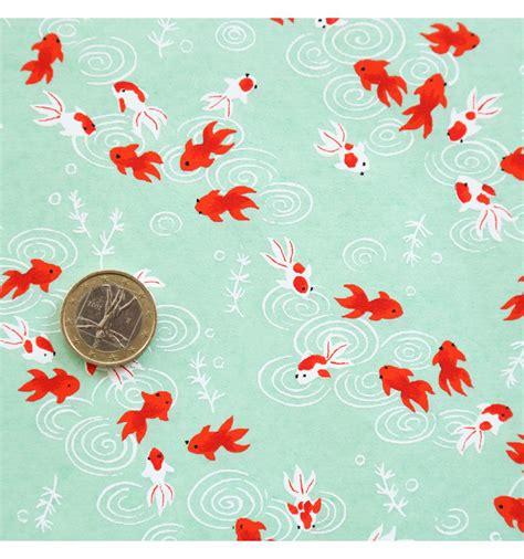 papier japonais motif poissons rouges fond bleu