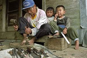 Filipino Wood Carver At Work With His Children Editorial ...