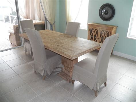 beach kitchen table and chairs double pedestal dining table with slip cover dining chairs
