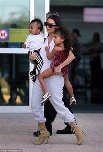 Kim Kardashian carries North and Saint | Daily Mail Online