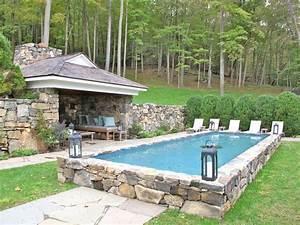 semi inground pool surrounded by stone semi inground With amenagement paysager avec piscine creusee 10 les plus belles photos de piscines bois hors sol semi