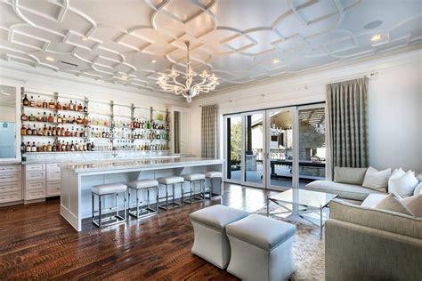 living room wet bar  geometric overlay panel ceiling
