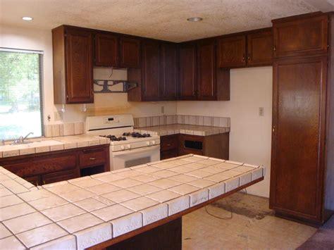 white shaker cabinets emerald pearl granite counter tops