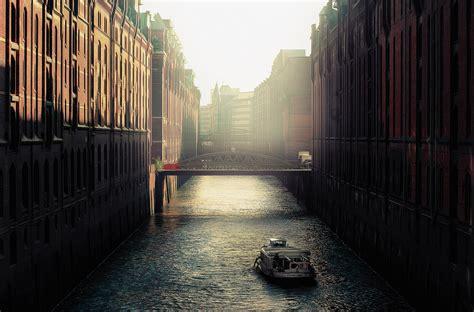 boat  river  city building wallpaper  hd