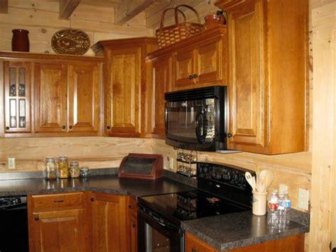 slab kitchen cabinets countertops and backsplash in log home kitchen 2296