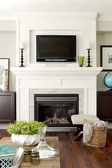 fireplace designs with tv above hanging your tv the fireplace yea or nay driven 8935