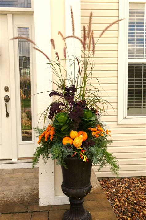 Fall Planter Using A Variety Of Kale Mums Grasses