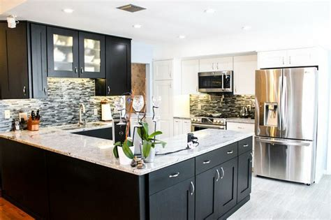 white kitchen cabinets with black granite countertops 15 stunning black and white kitchens page 2 of 2 zee 2202
