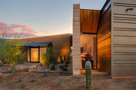 modern rammed earth home embraces  desert landscape