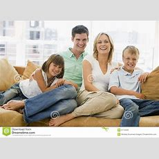 Family Sitting In Living Room Smiling Stock Photos Image