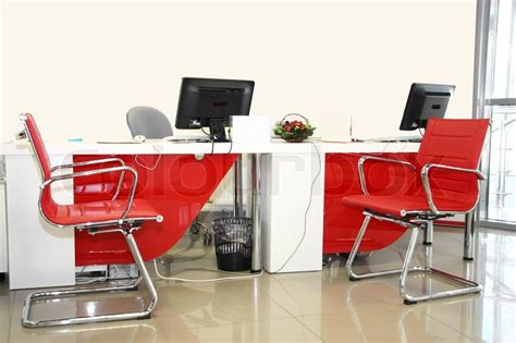 the image of empty office room with and white chairs