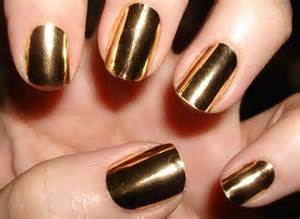 Golden nail paint with design impressions
