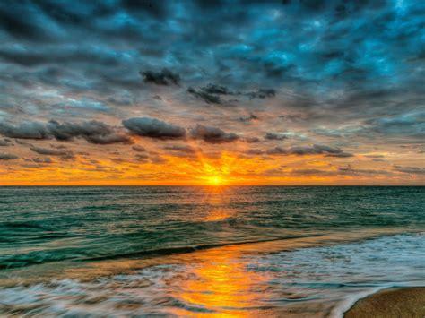 sunset sea ocean sandy beach waves red sky clouds summer