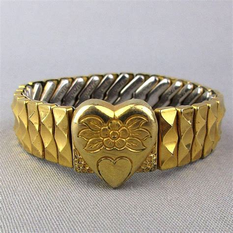 1940s Harwood Sweetheart Bracelet Etched Heart Expansion. Double Halo Rings. Wrist Wrap Bracelet. Karat Diamond. Black Onyx Rings. Custom Gold Chains. Halo Rings. Sparkling Wedding Rings. Gold Ankle Bracelets With Charms