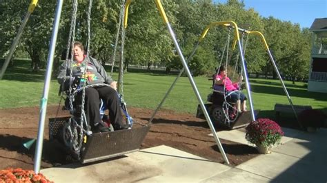 handicap swing wheelchair accessible swings taking home in