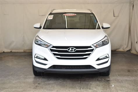 Every used car for sale comes with a free location: 2018 Used Hyundai Tucson SE AWD at Car Factory Outlet ...