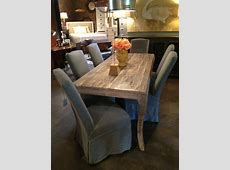 One of our favorite dining tables gray slipcovered
