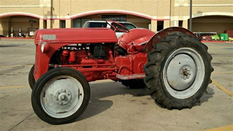 postwar farmers dream  ford  tractor