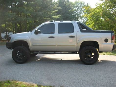 buy   chevy avalanche lots invested lifted