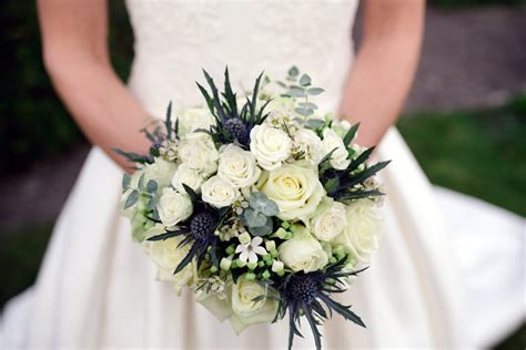 white rose thistle bridal bouquet driftwood flowers