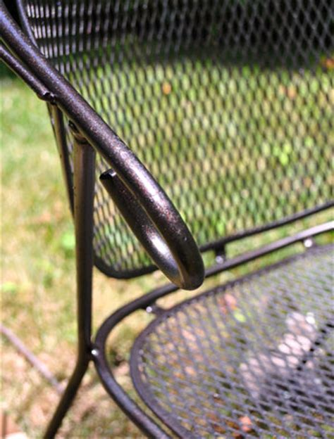 spray painting a metal outdoor table chairs with