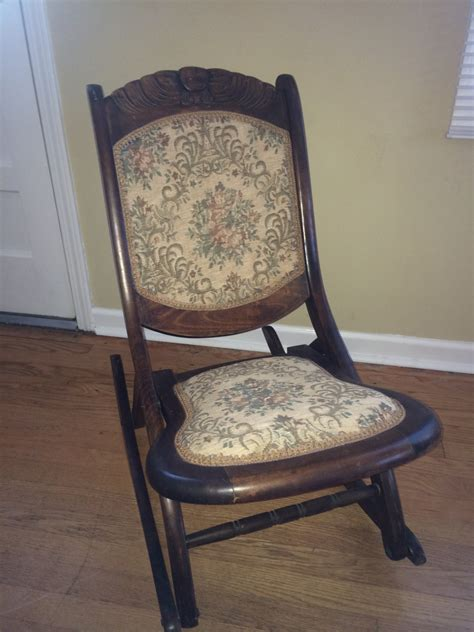 wooden carved antique rocking chair embroidered seat and