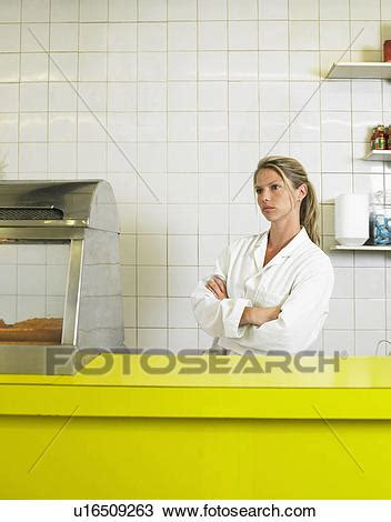 stock photo  young woman  counter  fish  chip