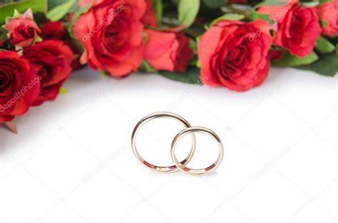 wedding rings and flowers isolated white background 169 elnur 113993622