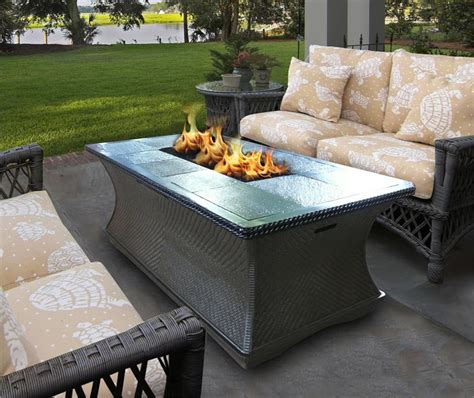 Handcrafted from concrete and steel, the center comes filled with lava. Outdoor Gas Fire Pit Coffee Table Monterey Series