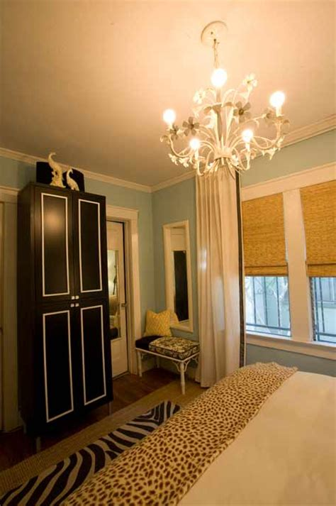 Black and white striped accent chairs add a finishing touch of fun and eccentricity, making the room less dramatic and more modern. Black and White Armoire - Contemporary - bedroom ...