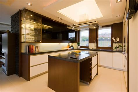 modern kitchen with ceiling lighting and kitchen cabinets
