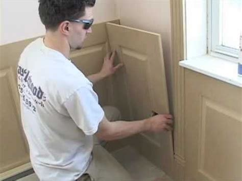 Installing Wainscoting panels - YouTube