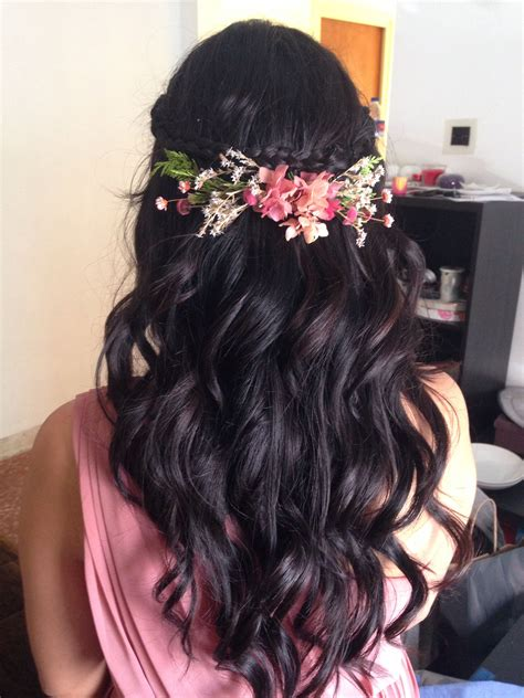 curly open hair adorned with floral hair clip bridal