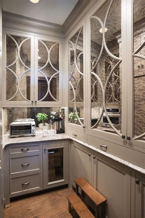 gray butlers pantry boasts antiqued mirrored eclipse