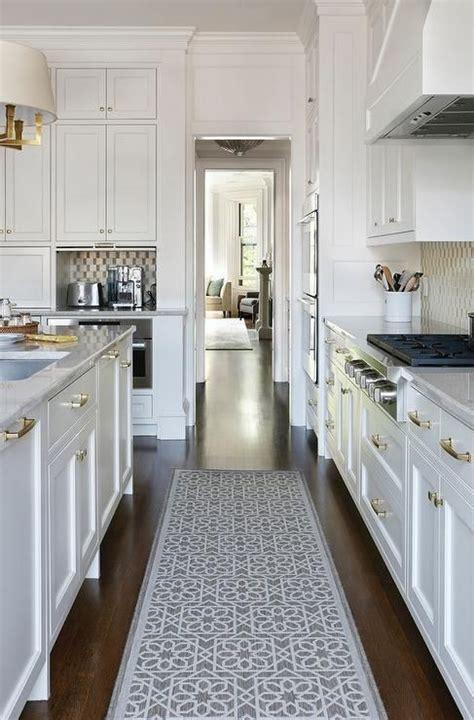 stunning white kitchen boasts  gray trellis runner