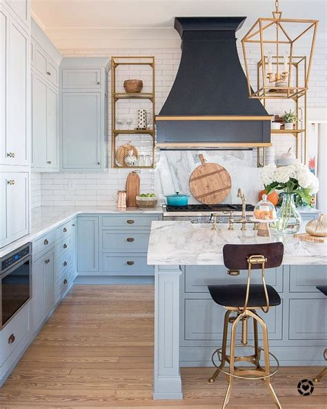 light blue paint marble  brass kitchen design