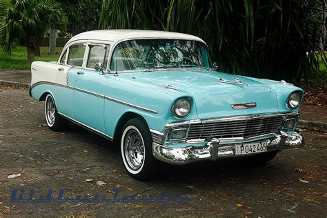 1958 Chevy Impala And An Old Ford…