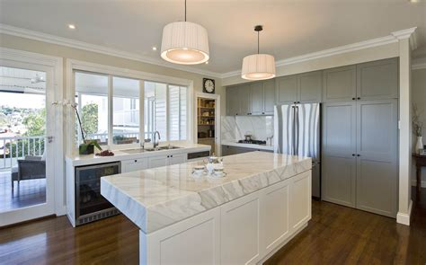 open kitchen design with island vaulted ceiling fireplace