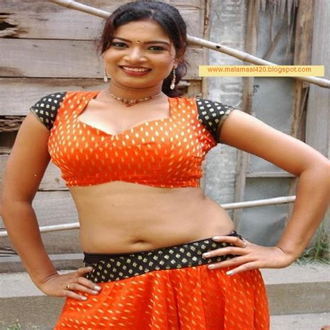 Sexy Bollywoods Actress And Mallus Madhu Sharma In Orange