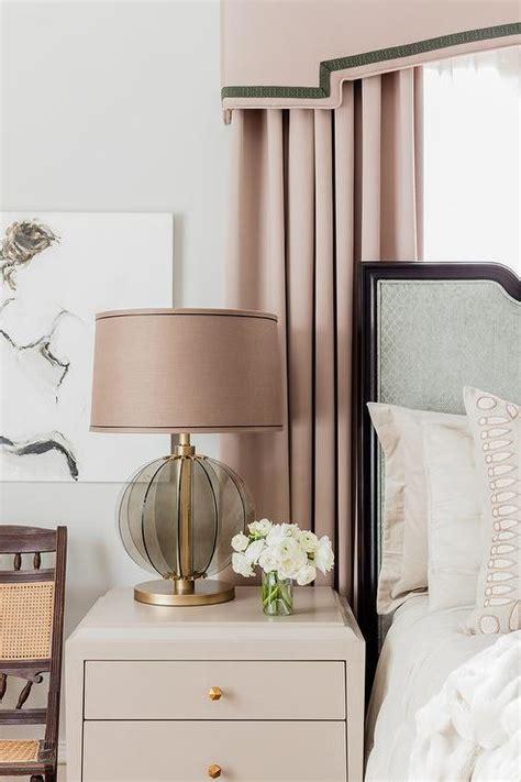 pink curtains  gray headboard transitional bedroom