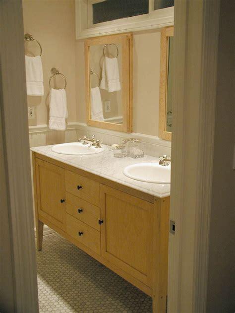 maple vanity  light sink   framed mirrors
