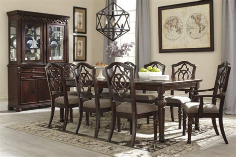 leahlyn rect dining room ext table 6 uph side chairs
